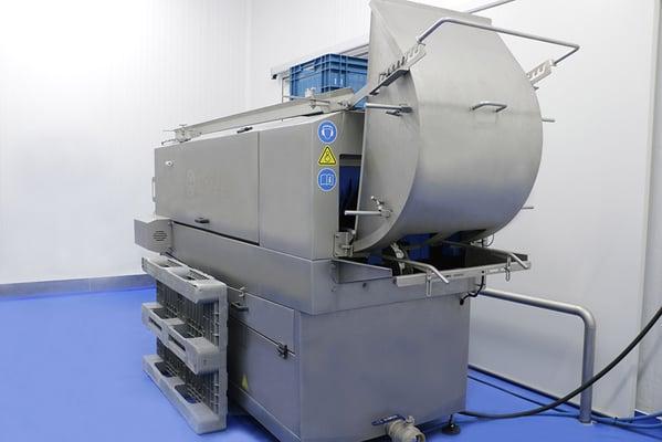 Faire l'acquisition d'une laveuse de bacs : un processus de l'orientation à la production